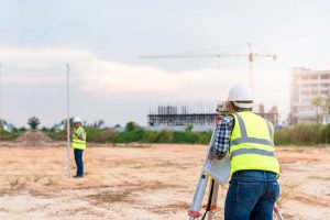 land surveyor working construction land preparation